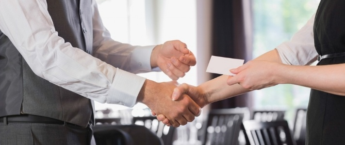 Business people shaking hands after meeting and changing cards in restaurant-129997-edited.jpeg