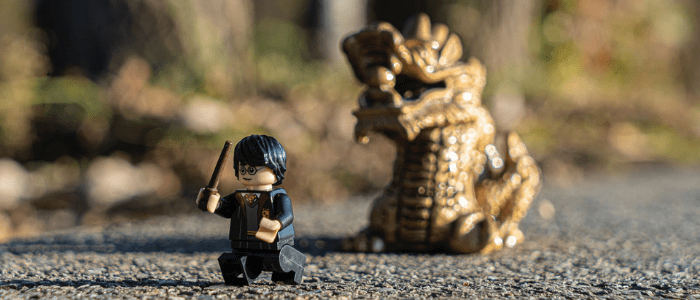 Harry Potter Lego Man Running From Dragon