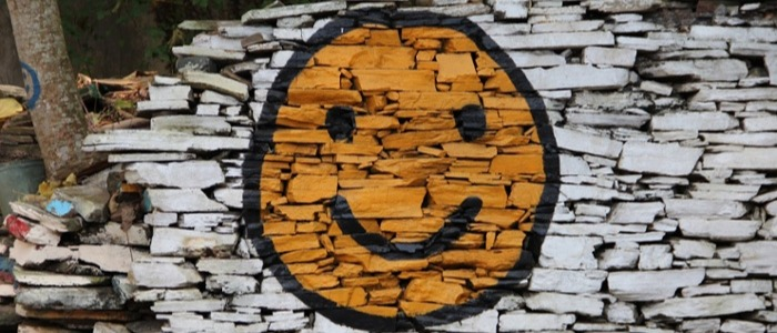 Smiley face painted on a wall