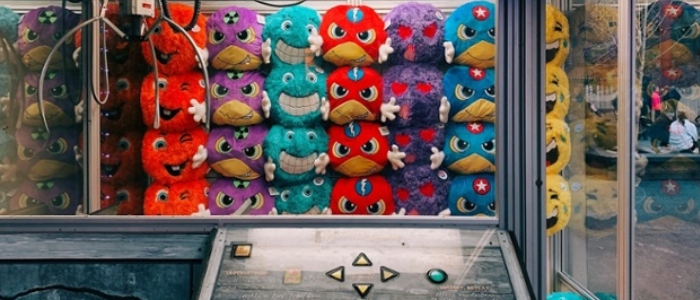 Claw machine filled with soft toys