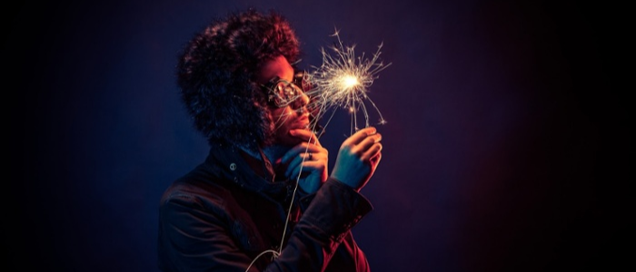 Man in sunglasses holding a sparkler