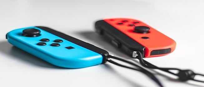 Blue and red gaming console controllers