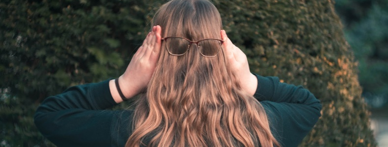 Gen Z woman with glasses on the back of her head